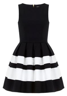 Love this style... we have a similar dress in our collection, www.shopuptownsociety.com