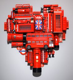 All the iconic red things of London: buses, mail boxes, telephone booths, Underground signs, and royal guards.