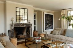 Neutral colors are a popular choice when designing an interior of contemporary living rooms. Find out how to create a striking decor of living room in neutral palette. Beige Living Rooms, Living Room Decor, Living Spaces, Dining Room, Santa Monica, Fireplace Art, Fireplaces, Distressed Fireplace, Black Fireplace