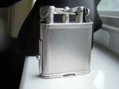 Dunhill pipe lighter. With tamper..