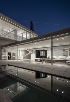 Without a formal entry point, openings along the length of the lower level merge the interior and the exterior and allow a daily and unformal passage between the inside and the outside.  Photo 10 of The Dual House modern home