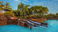The twin waterslides of Bay Slides empty into a tranquil section next to the Surf Pool