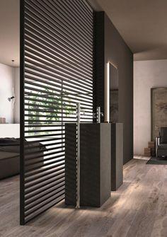 De stripe deur als scheidingswand tussen slaapkamer en badkamer