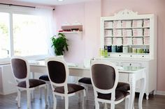 The manicure area seats three clients at a time on Misk's specially designed wooden manicure table near one of the larger windows.
