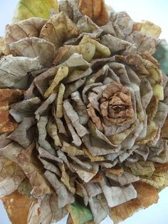 Step by Step Tutorial for creating this Rosette wall or door decor using dried leaves and a cardboard base.