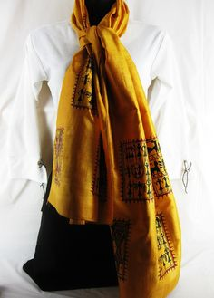 **** Going for Gold ****    The rich gold hues of this fabric change shades with the change in the angle of the light falling on it. The paintings on this one are in traditional Tribal East Indian style, depicting scenes from everyday life.    Women's Traditional Hand Painted Scarf by ArachneStyle on Etsy, $80.00