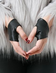 Genuine Leather Lambskin Punk Half Cropped Fingerless Mini Gloves XXS (16cm to 16.5cm)    material: genuine lamb leather. sheer polyester lining. female size: XXS, very tiny! fit children or extremely small palm bwteen 15cm to 16.5cm 1 pair set: left and right gloves   * made of top quality genuine lamb leather fitted fingerless gloves for extremely small female hands * size XXS gloves are made for EXTREMELY small, less than 16.5cm palm * very thin, sheer, silky smooth lining…