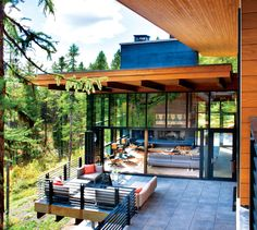 A Modern Nest in the Forest of Whitefish, Montana, contemporary modern, home design in mountains, mountain living architecture, outdoor living, deck, patio, outdoor spaces