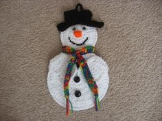 This is such a cute snowman potholder. He is crocheted using worsted weight yarn. Has black wiggly eyes, orange nose, 3 buttons down the front and a . Christmas Items, Christmas Holidays, Christmas Ornaments, Crochet Yarn, Crochet Flowers, Cute Snowman, Snowmen, Crochet Embellishments, Crochet Kitchen