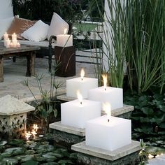#candles. Love the square candles on a stone slab plinth!