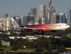 A sweet Etihad Airways A340-600 flaunting the special Abu Dhabi Grand Prix 2012 paint.