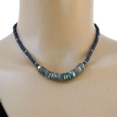 Dark blue faceted Sapphires mingled with tiny handmade silver beads surround gorgeous color flashing wheels of Labradorite. It closes with a lobster claw clasp and has an extender chain with another Sapphire and a tiny handmade fine silver bead dropping from the end of the chain to adorn the back of your neck.  All metal is solid .925-.970 sterling and fine silver.  Sapphire - approx. 4mm Labradorite - approx. 9-10mm  Length - approx. 16 long, extending to 18  This necklace is made to order…