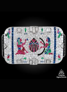 An Art Deco Egyptian Revival platinum, diamond and gem-set brooch, French, 1920s. Set with diamonds, rubies, emeralds, sapphires and onyx. #ArtDeco #EgyptianRevival