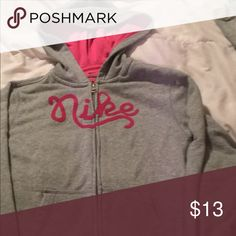 Nike Gray zip up hoodie girls size large Nike gray And pink zip up hoodie with no stains or tears gently used from a smoke free home. Nike Jackets & Coats