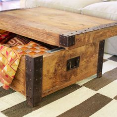Sliding-Top Trunk Table. Recycled pine with iron. Great as a coffee table, but also works as a foot-of-the-bed trunk for the bedroom.