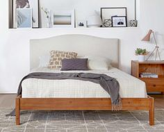 Dania - An equal mix of contemporary and industrial chic styles, the Petra bed is a smart addition for transitional spaces. The durable frame is crafted from wood for a timeless look and the headboard is upholstered in linen adding a layer of softness to the aesthetic. Queen bed pictured. Click below for additional sizes.