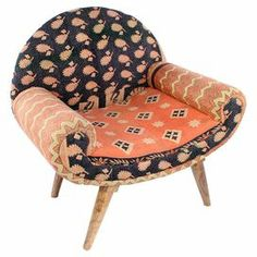 """Showcasing a midcentury-inspired silhouette and vintage kantha cloth upholstery, this one-of-a-kind arm chair brings bright bohemian-inspired style to your decor.   Product: ChairConstruction Material: Mango wood frame and cotton fabricColor: MultiFeatures:  Kantha embroidered Vintage fabric  Dimensions: 31"""" H x 22"""" W x 33"""" DNote: Some assembly requiredCleaning and Care: Spot clean"""