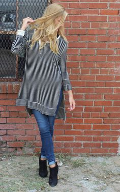 Gwen Henley by Free People clothing, boho fashion, bohemian style. Very soft henley style pullover with button placket at rounded neckline.  Neckline & cuffs trimmed with contrast khaki fabric. Long Sleeves & hi-lo hemline with deep side slits.  Top stitch detail at armholes & above hemline. Rayon, Spandex