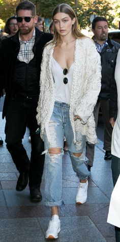 Gigi Hadid was spotted leaving the hotel George V in Paris wearing a Braided Pearl Jacket and Pearl Studded Distressed Jeans both by Jonathan Simkhai, a customized Re/Done The Muscle Tee, Ray-Ban RB3547 Oval Flat Sunglassess, and Reebok Classic Leather White Sneakers.