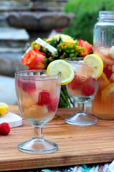White sangria with nectarines, raspberries, lemons, St. Germain and ginger ale is a delightfully citrusy and refreshing sipper that will quench your thirst for summer and sunshine.