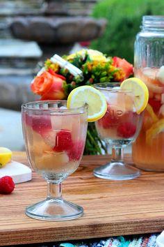 White Sangria with nectarines, raspberries, lemon, St. Germain and ginger ale.  | @beckysuebakes | bakingthegoods.com