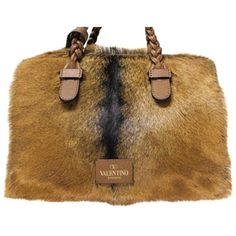 Pre-owned Handbag with fur trim (6.255 BRL) ❤ liked on Polyvore featuring bags, handbags, black, pre owned handbag, gold metallic handbags, valentino purses, preowned handbags and zip purse
