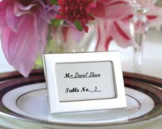 Events Wholesale - Memories by the Dozen - Set of 12 Miniature Photo Frames/Placeholders, $9.72 (http://www.eventswholesale.com/memories-by-the-dozen-set-of-12-miniature-photo-frames-placeholders/)