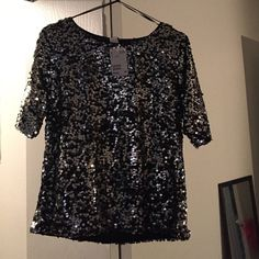 H&M sequin top Size small sequin silver grey top. Great for a formal or casual night out. H&M Tops Blouses