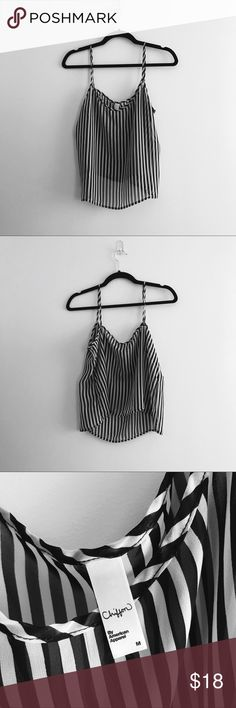 American apparel | Chiffon Striped Top medium American Apparel | Chiffon Striped Tank Top  Small snag in front of shirt other than that cute top! I like to style with tee under and a plain silk scarf in my neck  #americanapparel #chiffon #stripes American Apparel Tops Tank Tops