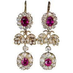 Imperial Era Russian Double Cluster Earrings  St. Petersburg, Russia  1908-1917  A pair of magnificent ruby and diamond double cluster earrings. Marked with 56 zolotniks gold standard (14K - 583)/ St Petersburg assay office, and jeweler's initials Cyrillic 'AB'