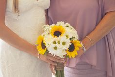 Bride's bouquet with sunflowers, white roses and daisies, hand tied with burlap and pearls