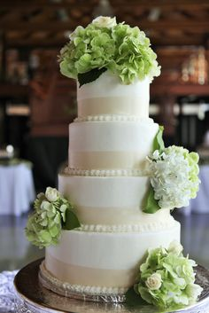 4 Tier Round Wedding Cake with Ribbon and Green/White Flowers