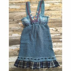 """Free People Nordic Mixed Media Sweater Dress Tag: Frost Blue.  Warm Fair Isle /Nordic Sweater Dress.  Body 80% Lambswool 20% Nylon.  Plaid Hemline with Raw Edge.  Trim 90% Wool 10% Nylon.  Neckline Boasts Ornate Metal Clasps.  Free Spirited Dress with Cozy Touches!  Bust 30"""".  Length 34"""". Hard To Find- New with Tag.  Please Note Free People Tag is missing a few stitches.  Still attached ( see photo).  No Trades. Free People Dresses Mini"""