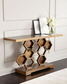"Handcrafted console table. 63.5""W x 18""D x 34.5""T. Oak, hardwood, wood composite, and steel. Stylized honeycomb and cast bees with drip welding. Mortise-and-tenon frame construction. Light assembly ma"