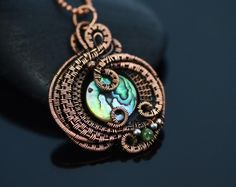 Wire wrapped necklace mother of pearl pendant wire weave abalone shell copper wire jewelry fantasy elaborate handmade jewelry elvish elf by OrioleStudio on Etsy https://www.etsy.com/listing/258856669/wire-wrapped-necklace-mother-of-pearl