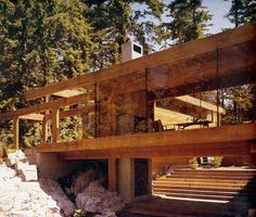 Smith House by Erickson and Massey - built in 1965 in West Vancouver features wooden beams and large glass panels composed as a set of post-and-beam rectangular tubes that spiral upward