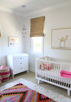 Trick out your baby's nursery with pops of happy colors.