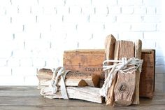 Firewood Bundle - All-natural firewood bundles tied with white rope. Great decor piece for corporate holiday parties or winter photo shoots.  *Paisley & Jade Vintage & Eclectic Furniture Rentals for Events, Weddings, Theatrical Productions & Photo Shoots*