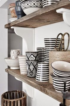 Shelves with mismatched dishes.