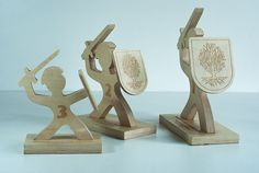 Statuette of the sport designed and built for the competition knight received the right shape - knights with shields. Statuettes are made of plywood shape Knights cut milling machine, subtitles and tree on disc laser engraved.