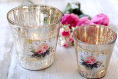 Silvered glass cache pots. try mercury technique then applique flowers, et viola your own tea lights.
