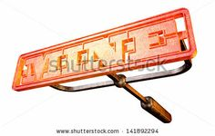 A metal cattle brand with the word mine as the marking area glowing red hot on an isolated background - stock photo