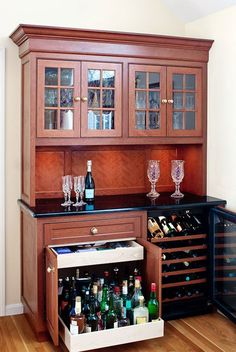 Love the pull out cabinet for heavy liquor bottles and shallow drawer for misc. bar items