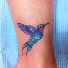 vibrant blue and purple hummingbird on the lower leg