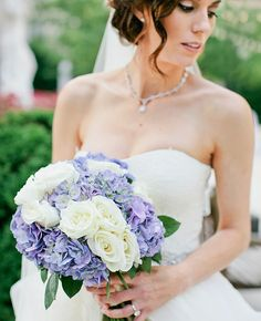 White roses and blue hydrangea bridal bouquet | Kristyn Hogan | blog.theknot.com