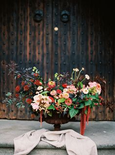 Note the tones, the dark leaves and the urn go with the background, the berries and vibrant reds....amaranth too.   Journal - Honey of a Thousand Flowers