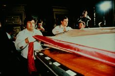 Tom D'Muhala and Dr. John Jackson position the Holy Shroud of Turin upon a specially designed table, for the Shroud's scientific examination.