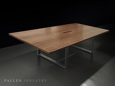 Straight edge conference table. Live edge custom furniture and architectural elements made from reclaimed wood and fallen trees by Fallen Industry. Fallen Industry is a home and office design studio based in NYC Brooklyn. Created by New York sculptor and designer Paul Kruger.