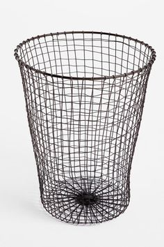 Woven Wire Trash Can  - this would make the coolest pendant light with an edison squirrel cage bulb.  i don't even think it would have to be drilled, just snake the cord through and hang with steel cable. #UrbanOutfitters