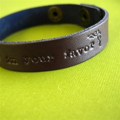 """""""May the odds be ever in your favor"""" leather cuff bracelet. 20 bucks. Loves it."""